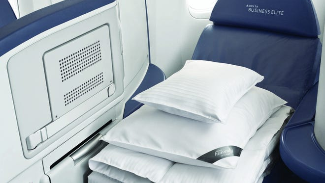Coming soon on Delta: Westin's 'Heavenly' bedding: Delta Air Lines business-class customers will be able to curl up with an in-flight version of Westin's signature pillows and comforters on international and select domestic flights beginning this summer.
