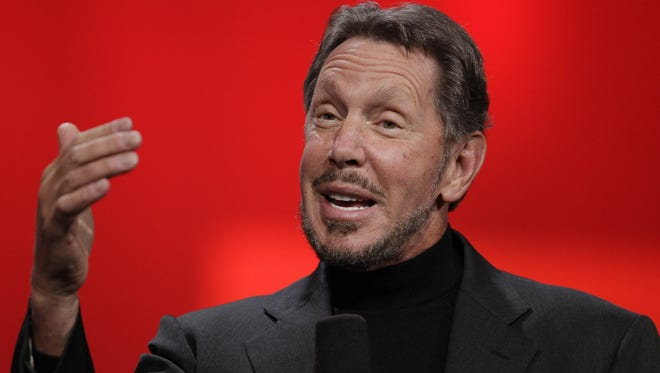In this file photo from Oct. 2, 2012, Oracle CEO Larry Ellison gestures while giving a keynote address at Oracle OpenWorld in San Francisco.