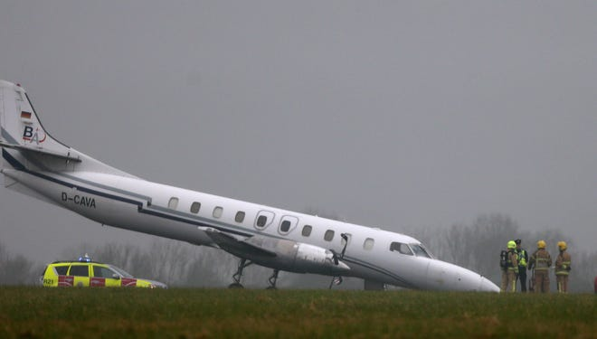 The scene of a plane incident at Dublin Airport after the front wheel of the Bin Air aircraft buckled on landing causing the accident on the runway on Thursday March 7, 2013.