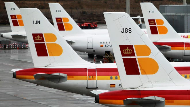 Iberia jets are seen at Barajas International Airport in Madrid on March 5, 2013.
