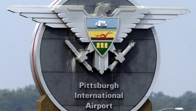 One of the signs for the Pittsburgh International Airport is seen along the entrance in Imperial, Pa. on July 29, 2004.