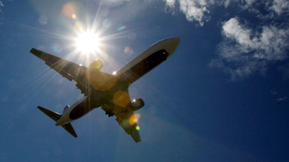 In this file photo from July 20, 2009, a plane flies into Portland International Airport in Portland, Ore.