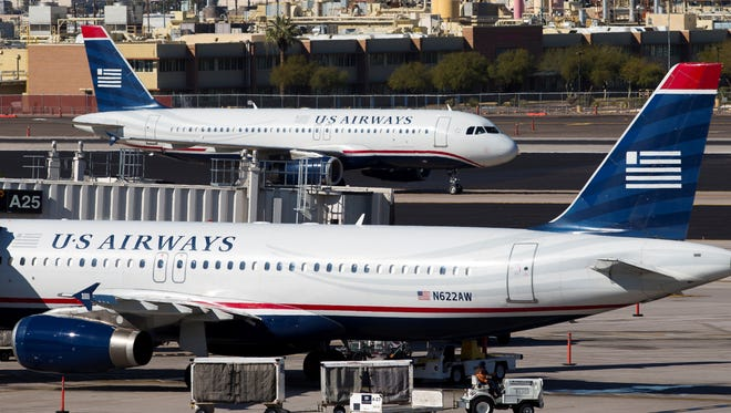 A US Airways plane taxis at Phoenix Sky Harbor International Airport on Feb. 13, 2013.