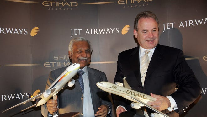 This photo from June 10, 2008 , India's Jet airways chairman Naresh Goyal (left) and Etihad Airways CEO James Hogan (right) pose at a joint press conference in Mumbai.