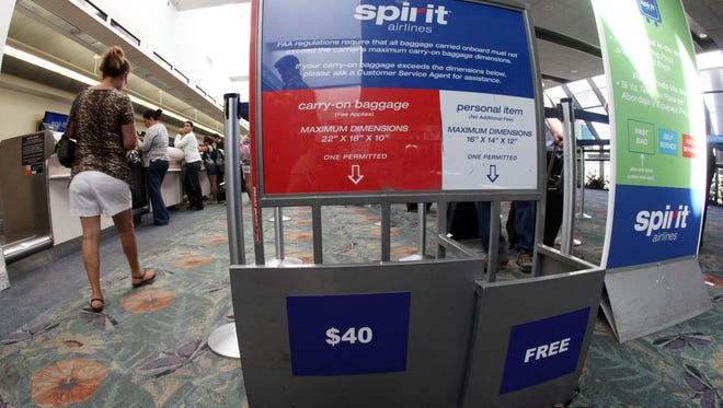 Spirit Airlines is among one of just three U.S. airlines to charge customers for both carry-on and checked bags.