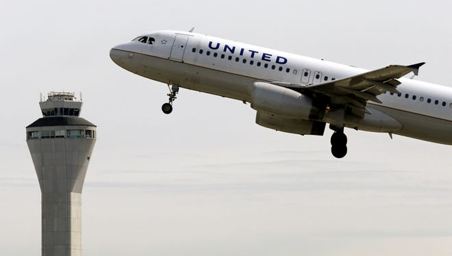 A United Airlines jet departs Seattle-Tacoma International Airport on April 23, 2013.
