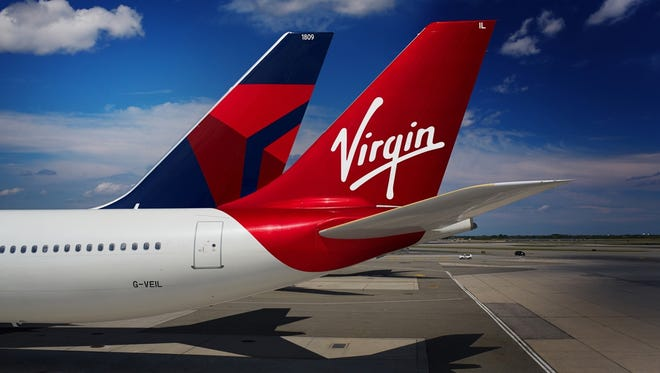 An image of the tails of Delta and Virgin Atlantic aircraft.