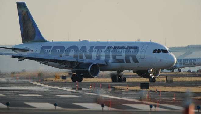 A Frontier Airlines jets at Washington's Reagan National Airport on Feb. 9, 2012.