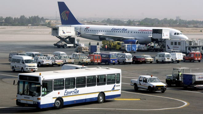 In this file photo from April 21, 2008, a bus and a plane are seen at the Cairo International Airport.