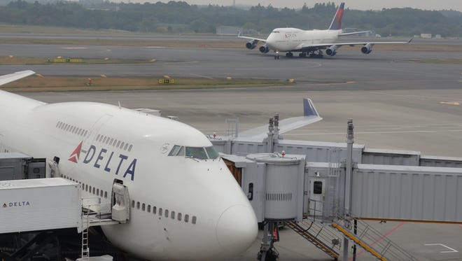 Delta Air Lines Boeing 747 jets are seen at Tokyo's Narita Airport on Nov. 2, 2011.