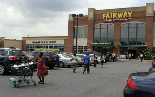 Local shoppers stock up on extra supplies in preparation for Hurricane Irene at Fairway shopping center in Pelham on Aug. 26, 2011. (Carucha L. Meuse/The Journal News)