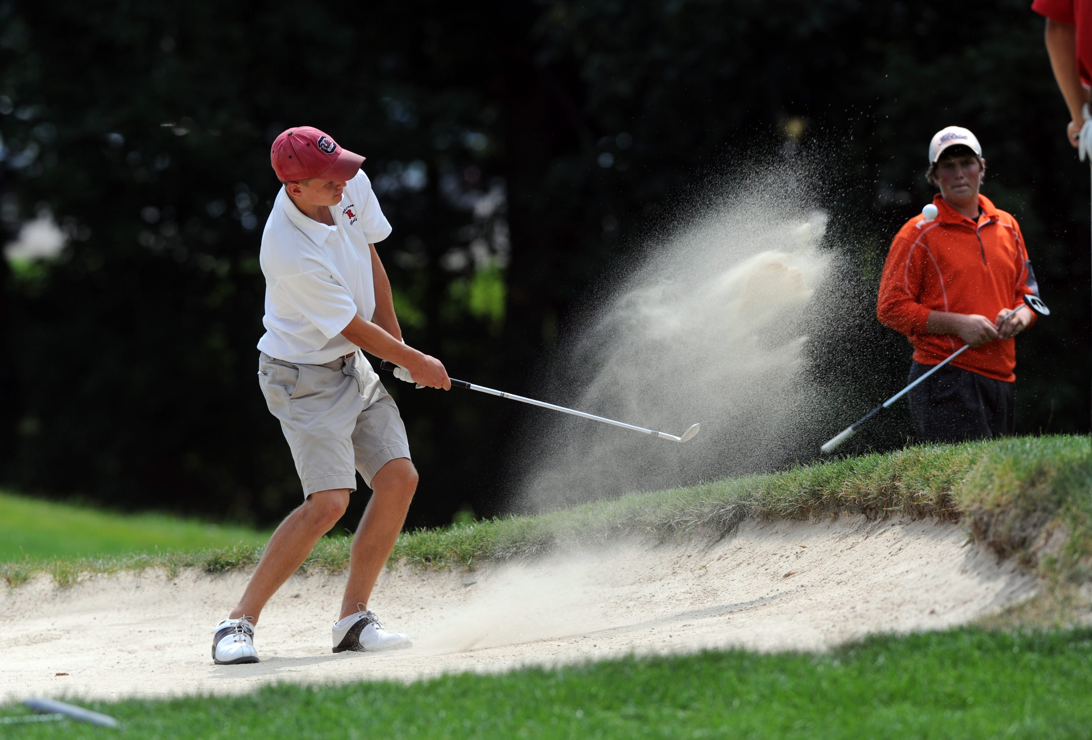 Rosecrans' Elliott Start hits out of a bunker Monday on the 12th hole at Zanesville Country Club.