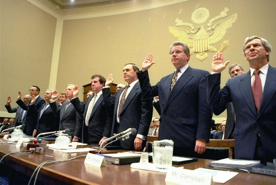 Heads of the nation's largest cigarette companies are sworn in before a House Energy subcommittee hearing on Capitol Hill on April 14, 1994.