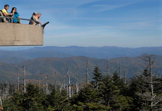 Visitors take in the view from the observation tower at Clingmans Dome Tuesday, October 14, 2008 in the Great Smoky Mountains National Park.