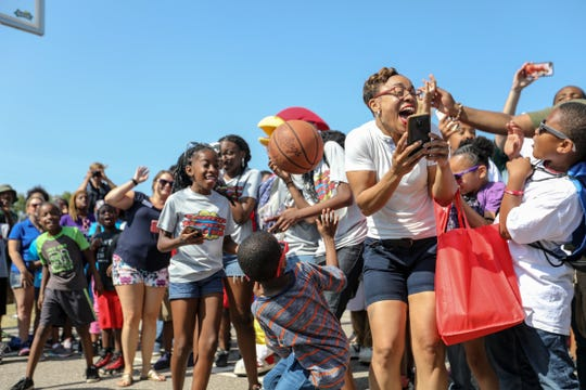 A basketball flies into the crowd as entertainer Ice Cube shoots around during Metro Detroit Youth Day at Belle Isle in Detroit on Wednesday, July 11, 2018.