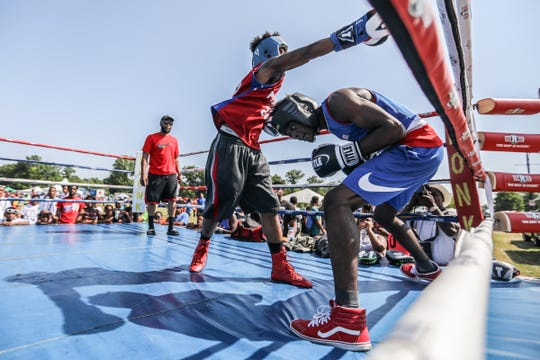 Bryant Brown, 17, of Detroit boxes with Deonte Cheeves, 18, of Detroit with Hands On Boxing during Metro Detroit Youth Day at Belle Isle in Detroit on Wednesday, July 11, 2018.