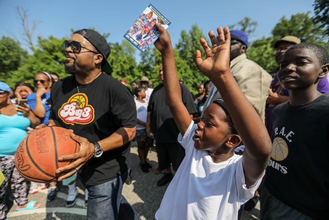 Daivon Robinson, 8, of Pontiac practices his shot, next to entertainer Ice Cube during Metro Detroit Youth Day at Belle Isle in Detroit on Wednesday, July 11, 2018.