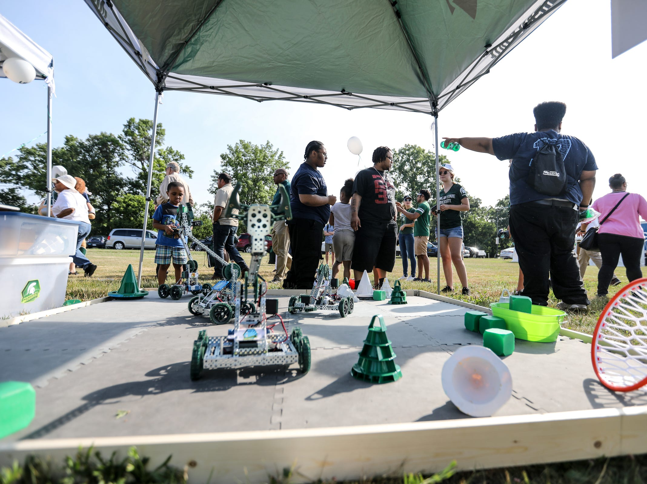 A Michigan State University engineering booth features robotics during Metro Detroit Youth Day at Belle Isle in Detroit on Wednesday, July 11, 2018.