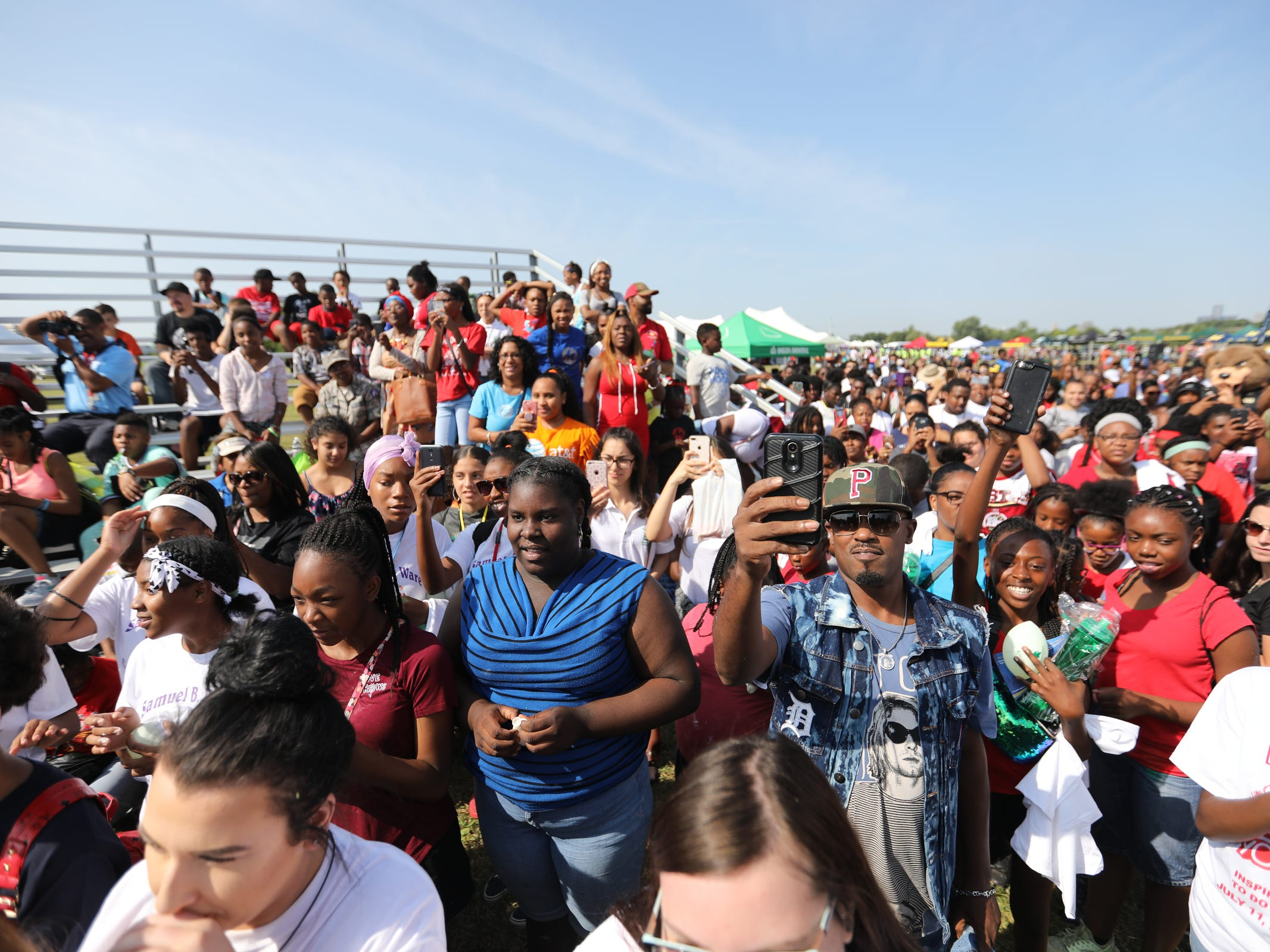 Crowds gather to see entertainer Ice Cube during Metro Detroit Youth Day at Belle Isle in Detroit on Wednesday, July 11, 2018.