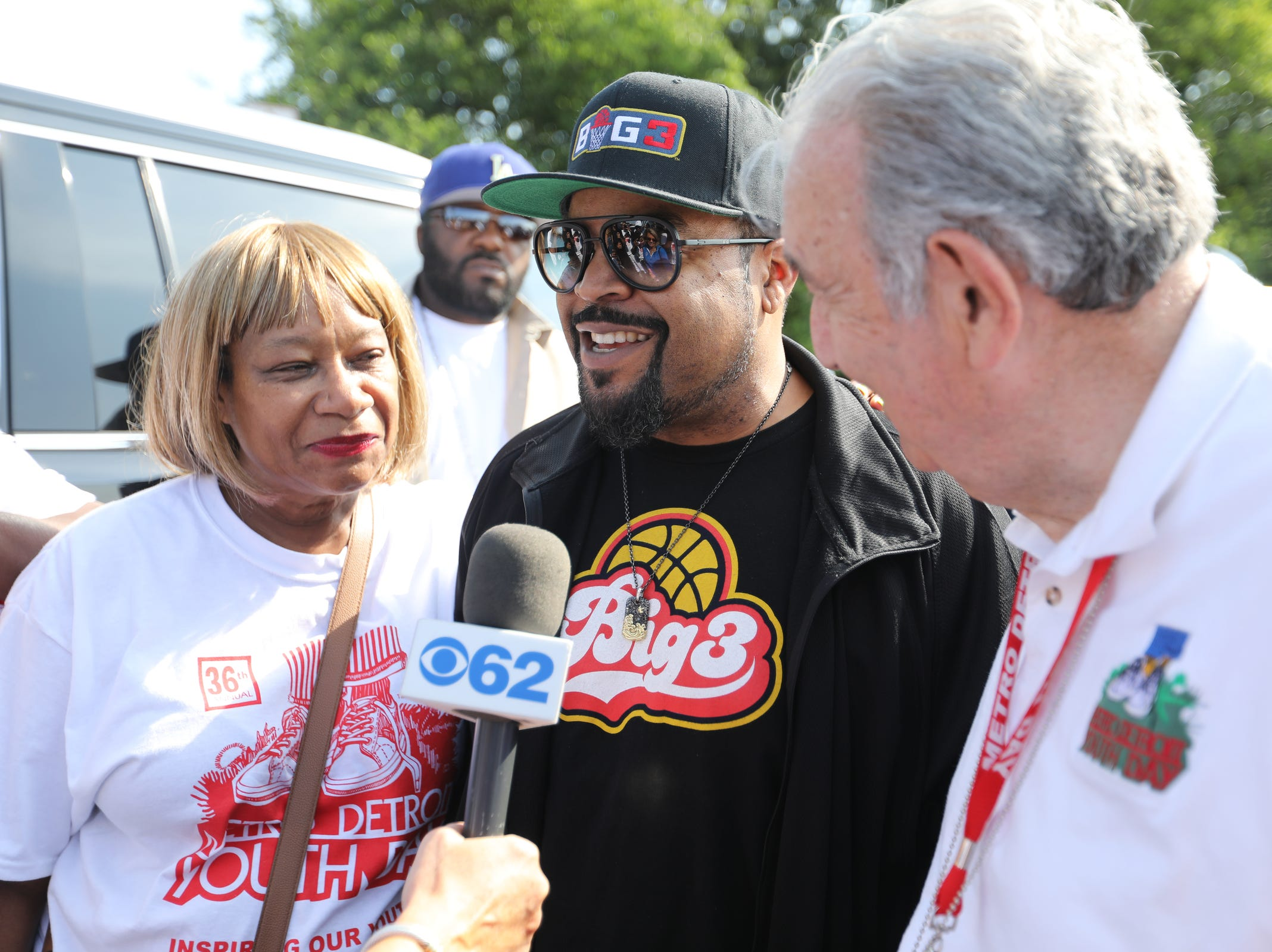 Entertainer Ice Cube speaks to the press alongside board members Barbara Jean Johnson, left, and Edward Deeb, right, during Metro Detroit Youth Day at Belle Isle in Detroit on Wednesday, July 11, 2018.