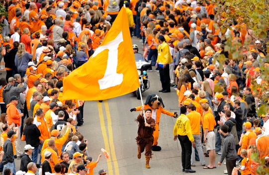 Tennessee's Volunteer mascot leads the Vol Walk waving the school flag before the game against South Carolina at Neyland Stadium in Knoxville on Saturday, Oct. 19, 2013.