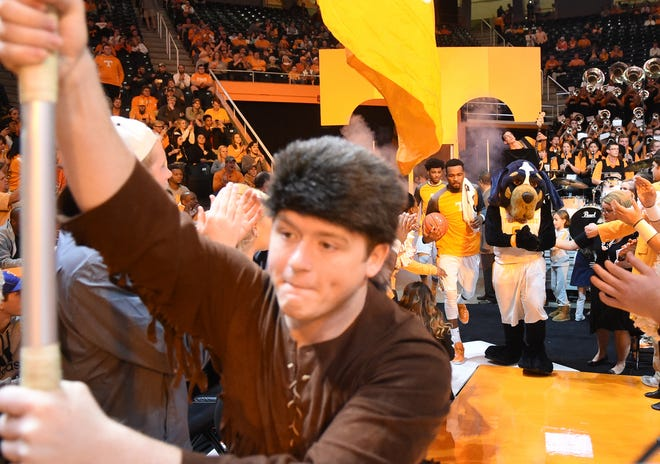 Tennessee guard Kevin Punter (0), second from right, emerges from the locker room with Tennessee's mascots  before the game against UNC Asheville at Thompson-Boling Arena on Friday, Nov. 13, 2015.