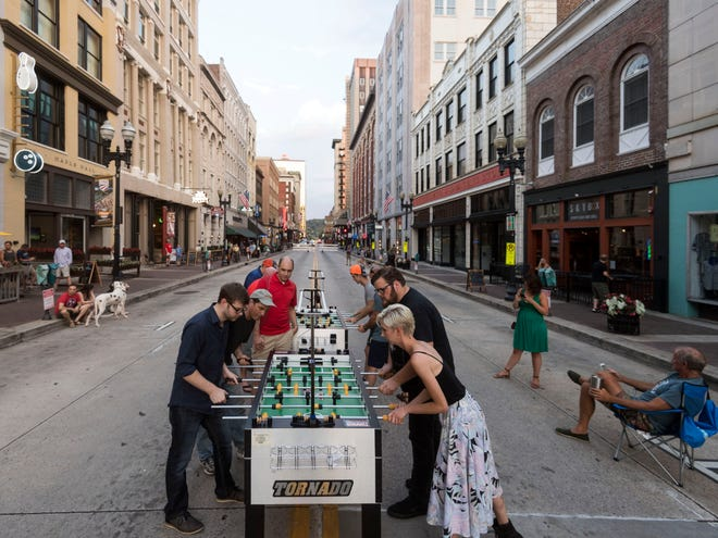Knoxville FoosVOL hosted their weekly game night on Gay St. on Tuesday, July 10, 2018. Two of the tables were moved outside from Suttree's Tavern while Gay St. was closed for repairs.