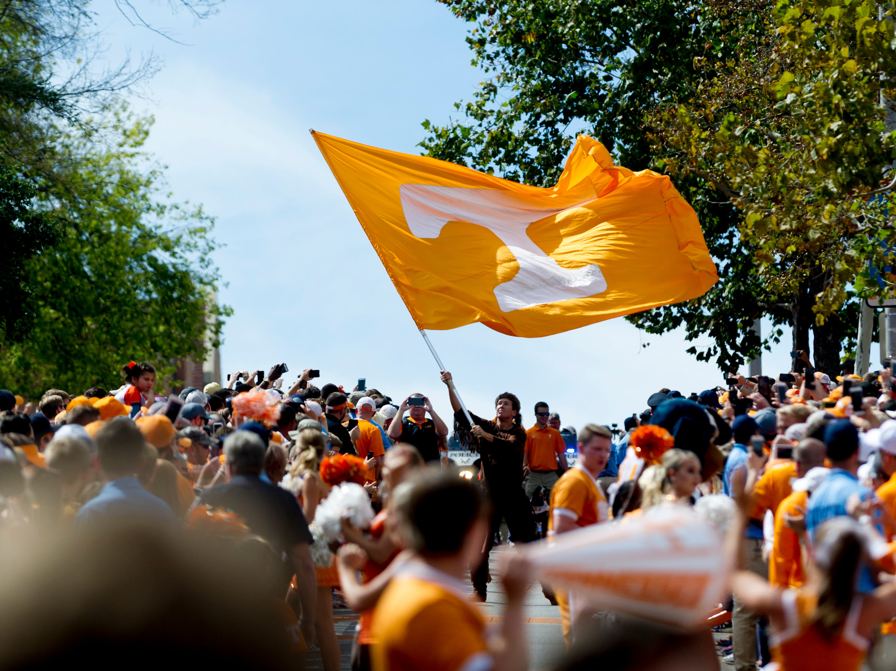 The Tennessee flag is flown during the Vol Walk during the Tennessee Volunteers vs. Georgia Bulldogs game at Neyland Stadium in Knoxville, Tennessee on Saturday, September 30, 2017.