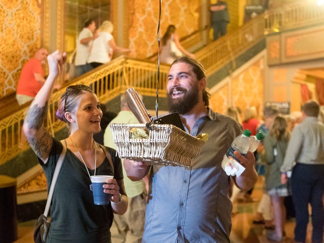 Emily and Sam Brouse of Asheville, NC are recognized as the 2 millionth visitor to the Tennessee Theatre on Tuesday, July 10, 2018.