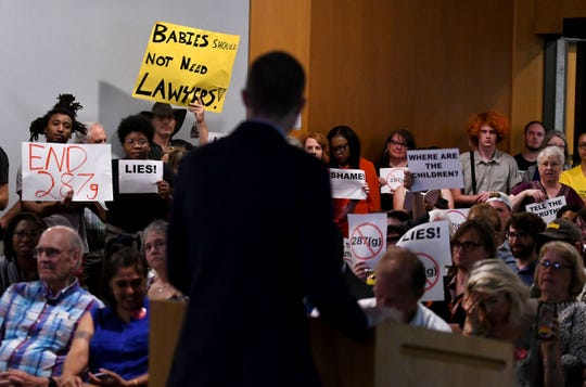 Bryan Cox, ICE spokesman, trying to speak at an ICE Steering Committee meeting in the small assembly room at the City-County Building. The protesters interrupted Cox many times Wednesday, July 11, 2018.