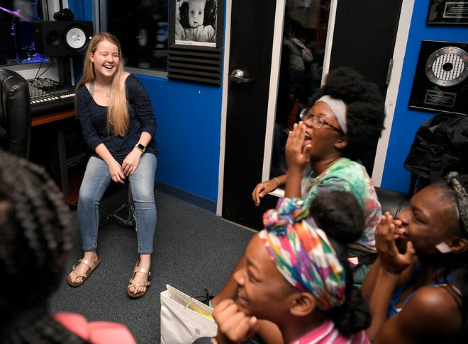 Franklin High student Sara Davis volunteers for Notes for Notes at Preston Taylor Boys and Girls Club helping students record a song on July 6, 2018.