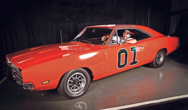 Rusty Robinson sits behind the wheel of his very own General Lee.