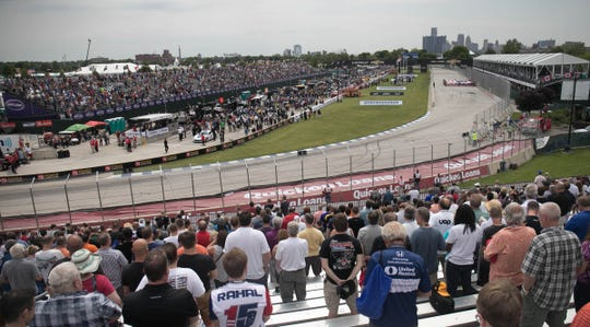 Fans watch the Verizon IndyCar Championship race during the Chevrolet Detroit Grand Prix in June 2017 on Belle Isle in Detroit.