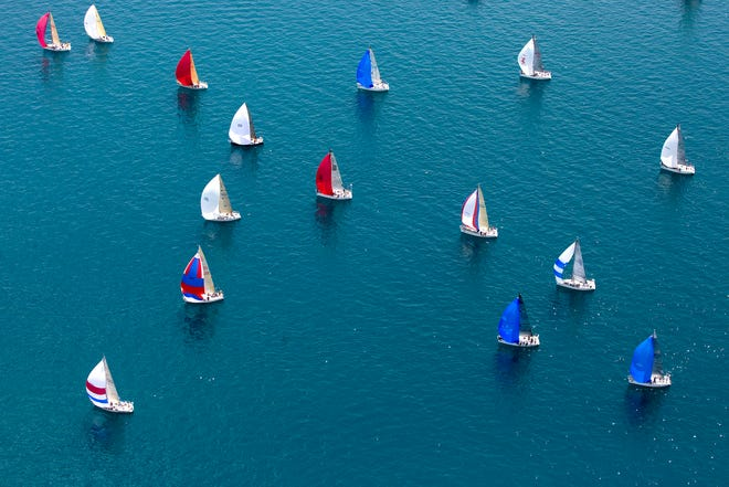 Boats take off from the start during the Port Huron-to-Mackinac Island sailboat race Saturday, July 18, 2015 on Lake Huron.