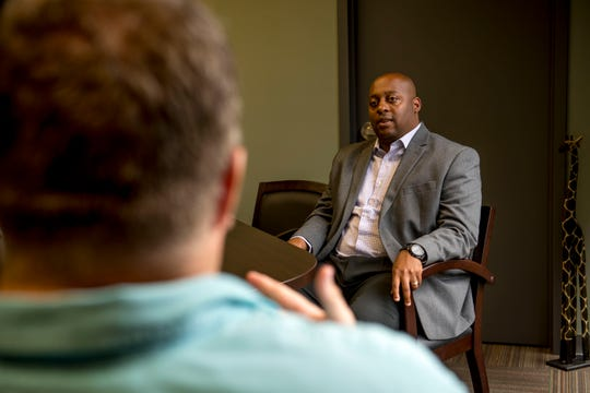 Eric Jones sits down for an interview with a Jackson Sun reporter at the Jackson-Madison County Board of Education in Jackson, Tenn., Monday, July 2, 2018.