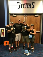 From left to right, Victor Vincelette, Tennessee Titans coach Mike Vrabel, Paul O'Keefe and Kelly Altschwager