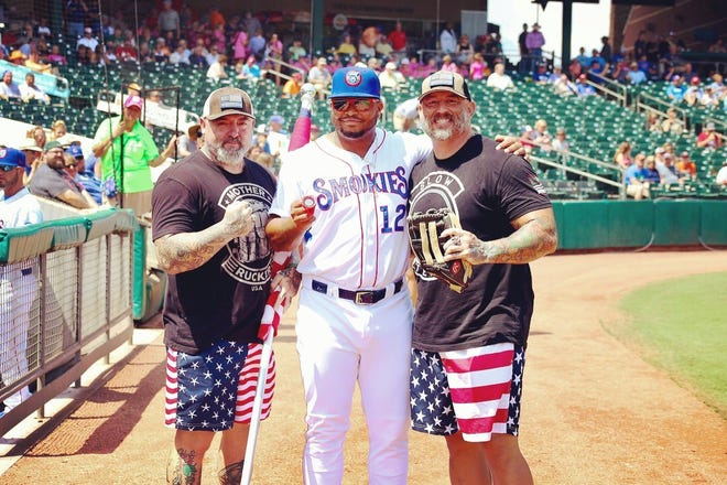 Victor Vincelette (left) and Paul O'Keefe (right) pose for photo with Smokies' first baseman Yasiel Balaguert.