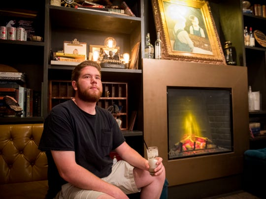 Knoxville News Sentinel urban life writer Ryan Wilusz enjoys a cocktail at Peter Kern Library as he attempts to complete his Knoxville bucket list in one day.