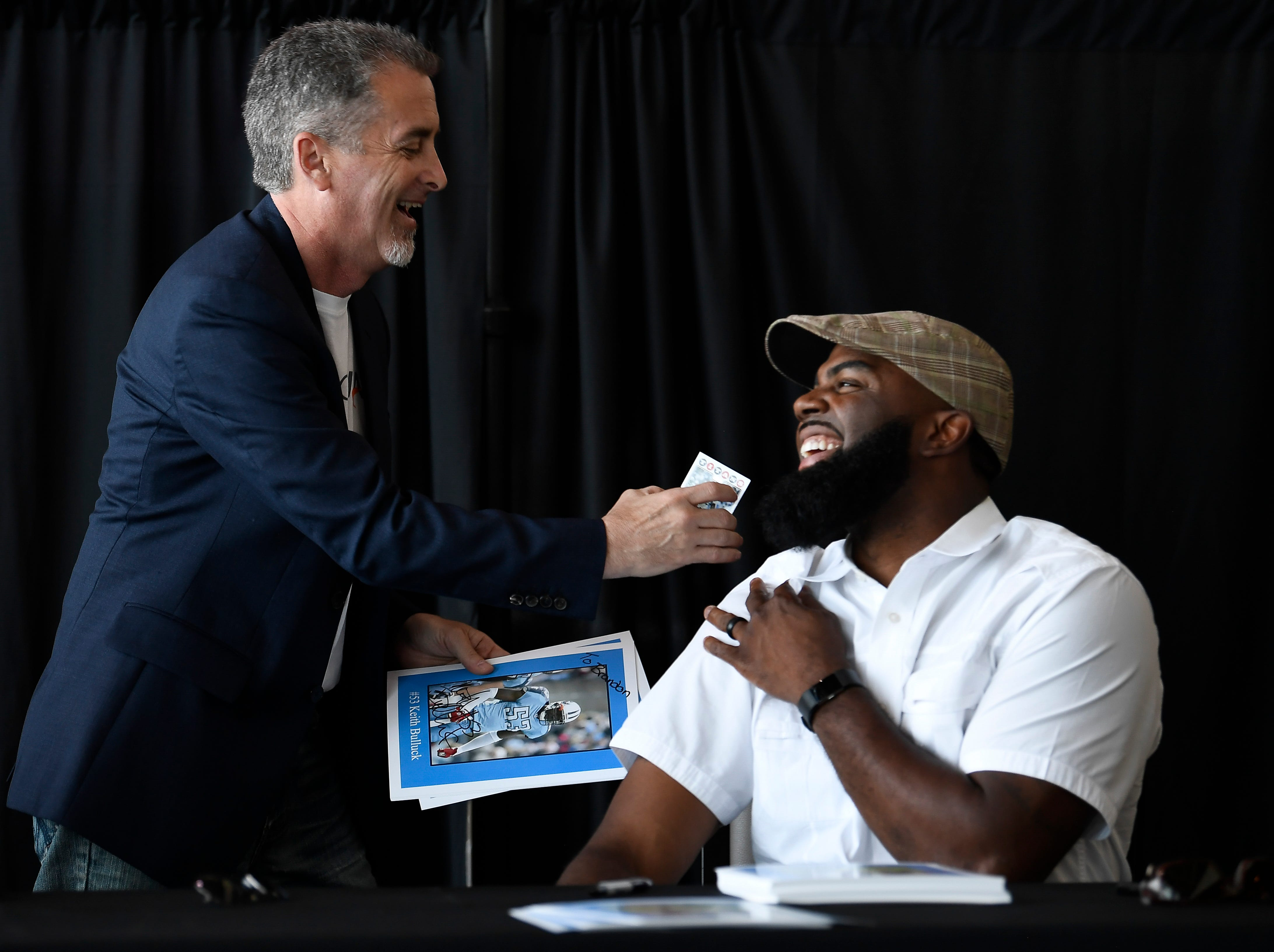 Former Titans wide receiver Kevin Dyson, right, shares a laugh with Rick Solovy of Chicago during a corporate event at Nissan Stadium Thursday, July 12, 2018, in Nashville, Tenn. Dyson recently earned his doctorate from Trevecca Nazarene University.