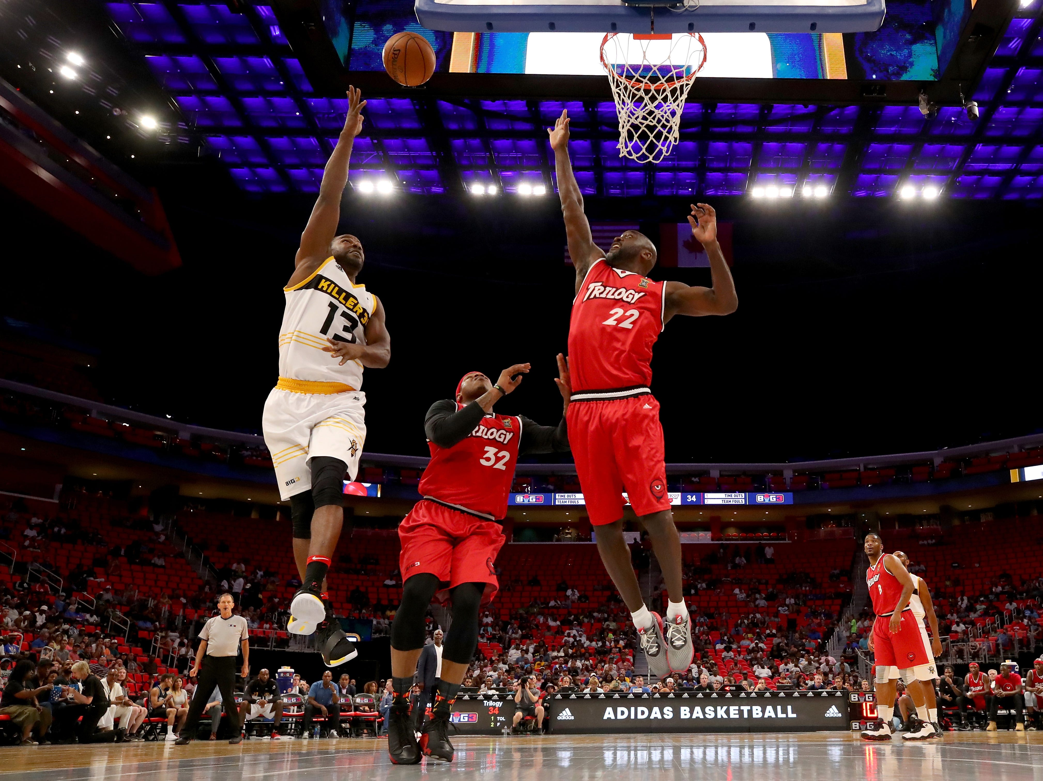 Mike James, left, of the Killer 3s attempts a shot while being guarded by Rashad McCants, center, and Dion Glover #22 of Trilogy during BIG3 - Week Four at Little Caesars Arena on July 13, 2018 in Detroit.
