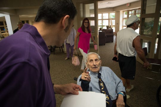 Charles Abud speaks to his nephew Rick Joseph at Shore Pointe Nursing Center in St. Claire Shores on Wednesday, July 11, 2018.
