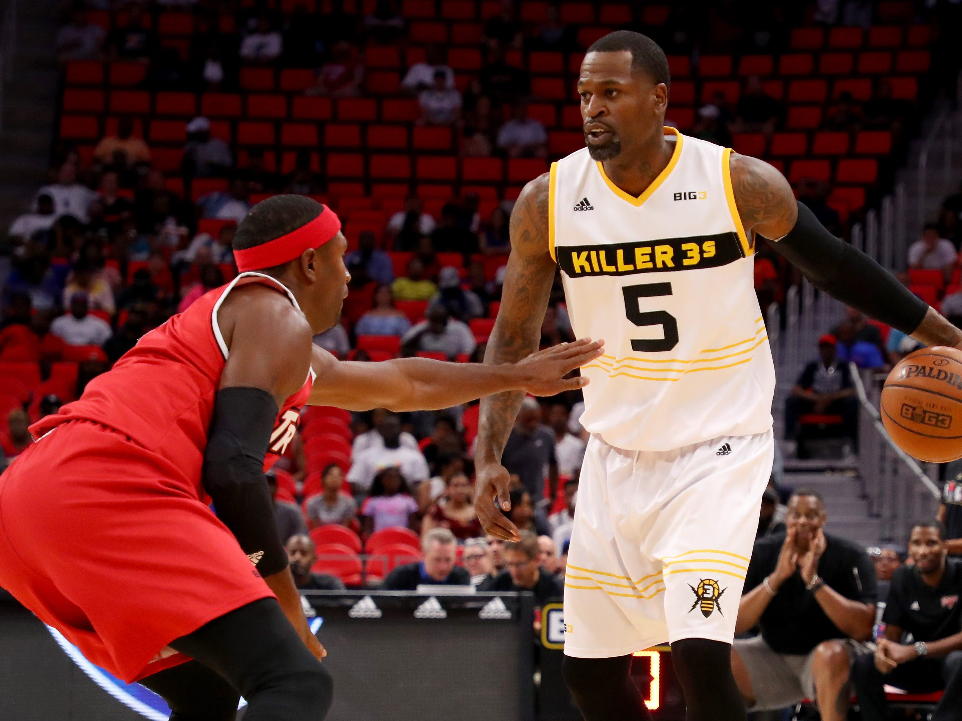 Stephen Jackson of the Killer 3s dribbles the ball while being guarded by Derrick Byars of Trilogy during BIG3 - Week Four at Little Caesars Arena on July 13, 2018 in Detroit.