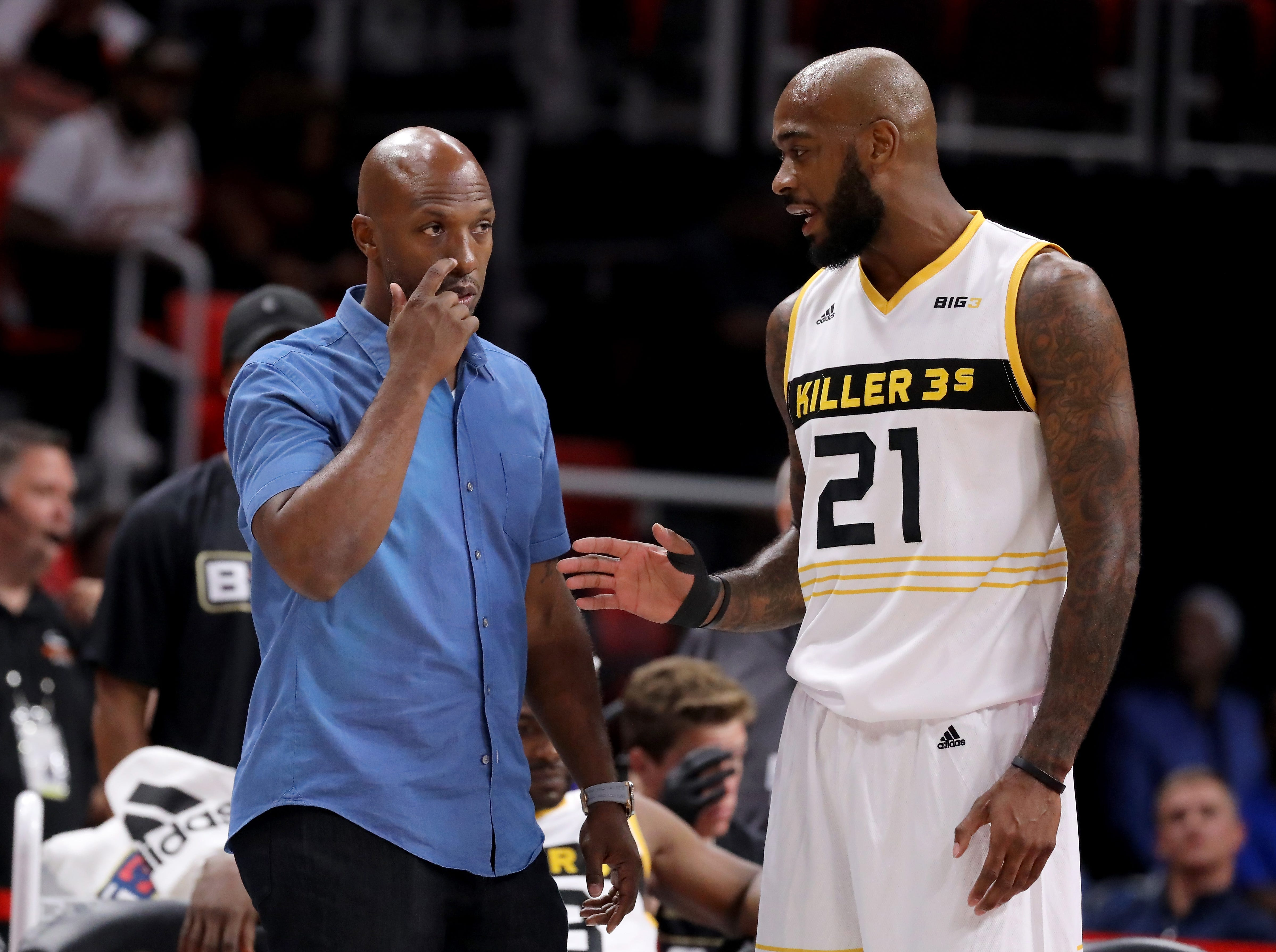 Chauncey Billups meets with Josh Powell of the Killer 3s during the game against Trilogy during BIG3 - Week Four at Little Caesars Arena on July 13, 2018 in Detroit.