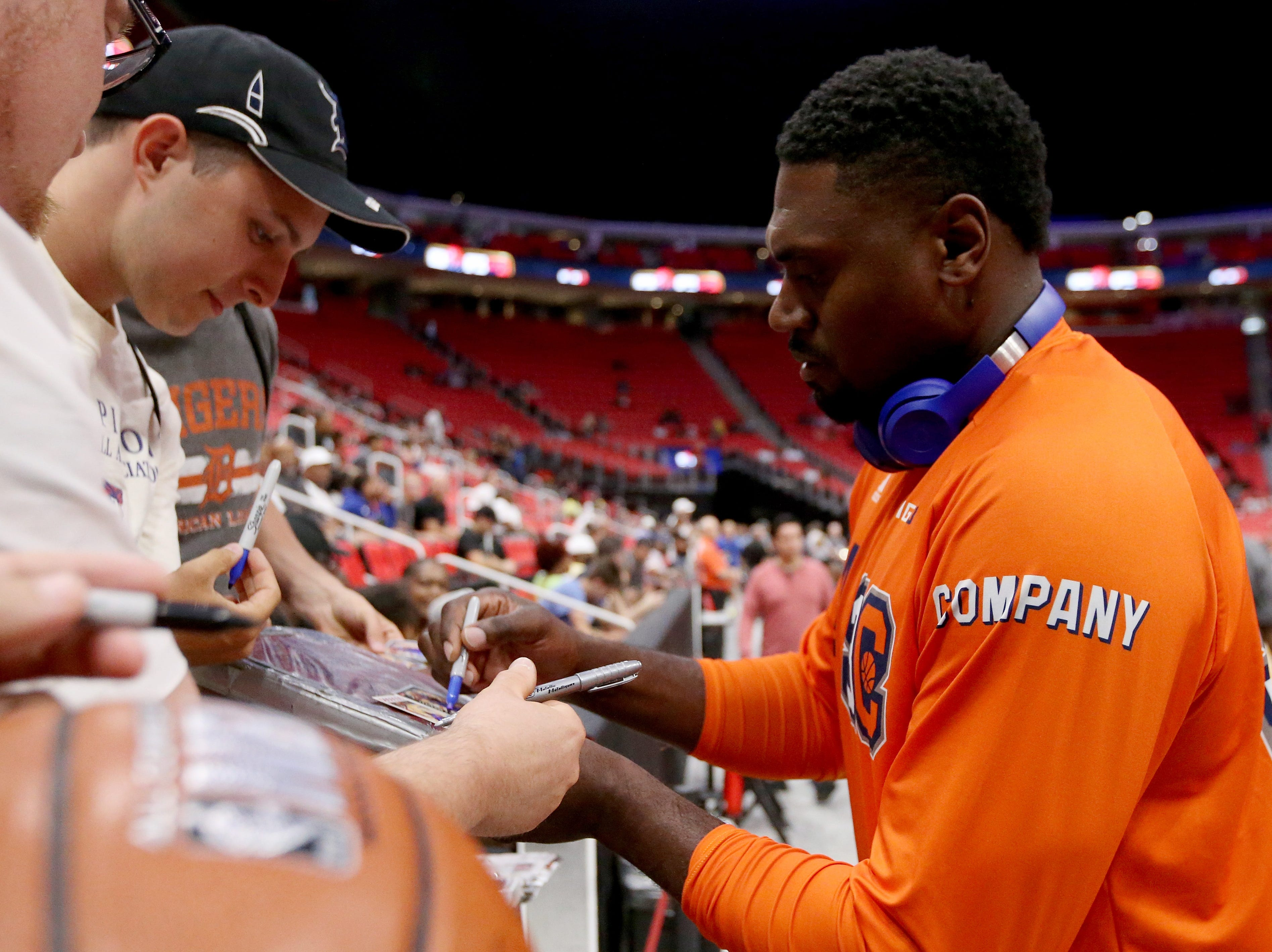 Jason Maxiell of 3s Company signs autographs for fans during BIG3 - Week Four at Little Caesars Arena on July 13, 2018 in Detroit.