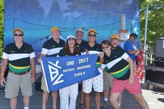 Pamela Wall and the crew of Chippewa, a Tartan 34, after receiving their third-place flag in Class N  at the end of the 2017 Port Huron-to- Mackinac Island race.
