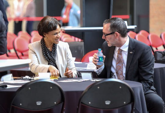 Denise Gray, president of LG Chem Michigan Inc. Tech Center, converses with Mike Jackson, exec. director for strategy and research at Original Equipment Suppliers Association, where they are both speakers during the 2018 US-Korea Business Summit at Little Caesars Arena in Detroit on Thursday, May 24, 2018.