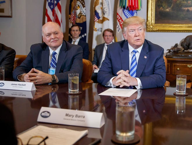 Ford CEO James Hackett and President Donald Trump during a meeting with automotive executives in the White House, Friday, May 11, 2018, in Washington.