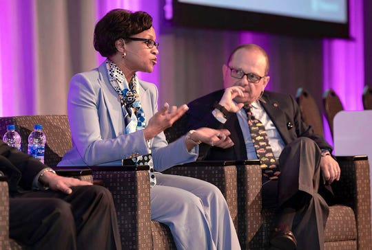 Denise Gray, president of LG Chem Michigan Inc. Tech Center and  V. Anand Sankaran, director of electrified powertrain engineering at Ford, take part in a panel discussion at 2018 CTI Automotive Week USA in Novi on May 16, 2018.