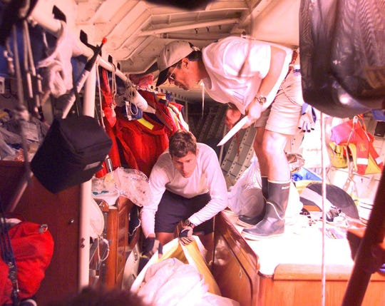 Joe Sarnecki, right,  preparing a meal of premade chicken breast and pasta salad for the crew aboard Allegiance, a Frers 50 during the Port Huron-to-Mackinac Island race.
