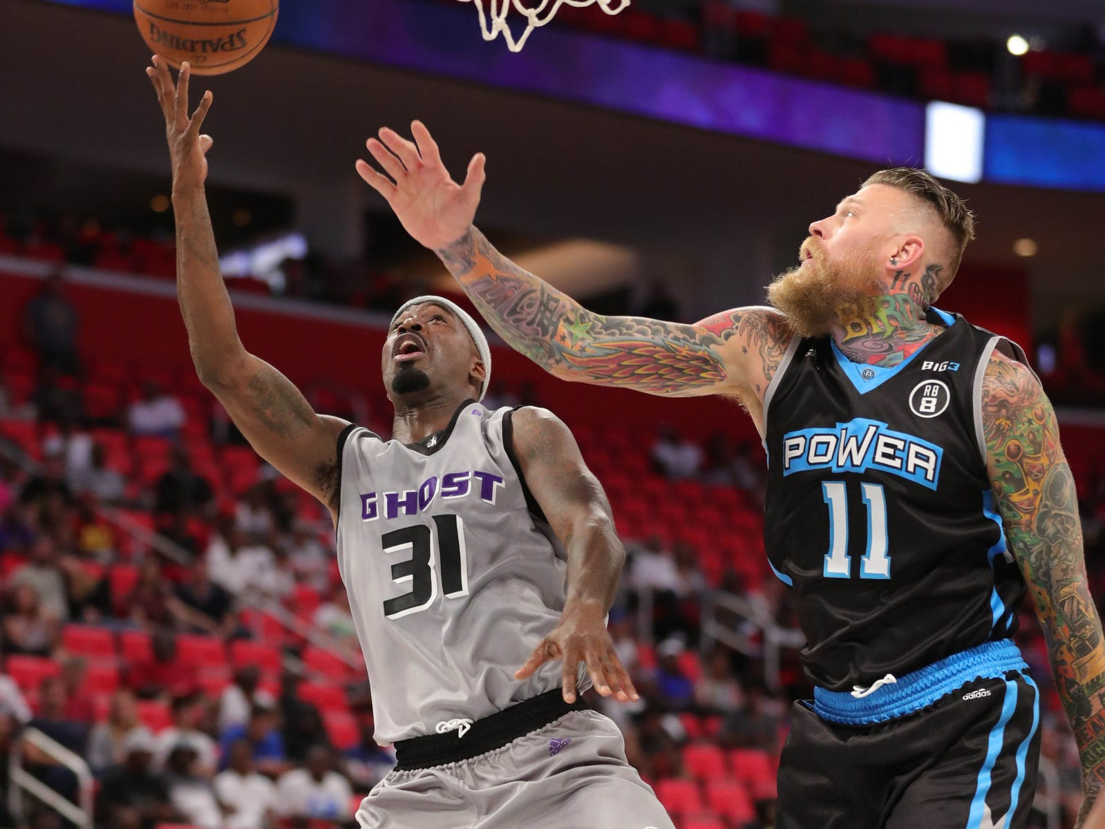 Ghost's Ricky Davis drives against Power's Chris Andersen during BIG3 action on Friday, July 13, 2018 at Little Caesars Arena in Detroit.